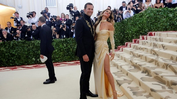 """Tom Brady and Gisele Bundchen arrive at the Metropolitan Museum of Art Costume Institute Gala (Met Gala) to celebrate the opening of """"Heavenly Bodies: Fashion and the Catholic Imagination"""" in the Manhattan borough of New York, U.S., May 7, 2018. REUTERS/Eduardo Munoz - HP1EE58018H87"""