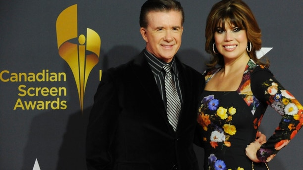 Alan Thicke and wife Tanya Callau Thicke arrive during the Canadian Screen Awards in Toronto March 3, 2013. REUTERS/Jon Blacker (CANADA  - Tags: ENTERTAINMENT)   - TB3E9331QY6XS