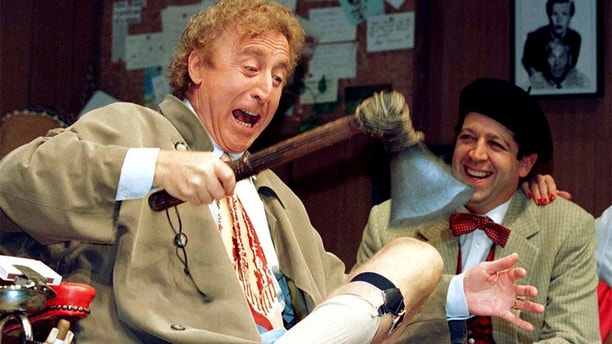 American actor Gene Wilder (L) performs alongside compatriot Rolf Saxon, during the rehearsal of a scene from Neil Simon's 'Laughter on the 23rd Floor', in New York, October 2, 1996. . REUTERS/Shawn Baldwin/File Photo     TPX IMAGES OF THE DAY      - S1AETYHHSEAA