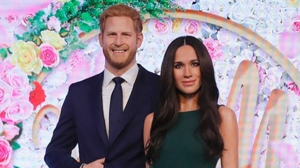 Britain's Prince Harry and his fiancee Meghan Markle are on display as wax figures at Madame Tussauds in London Wednesday