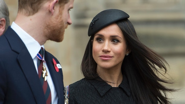 FILE - In this April 25, 2018 file photo, Britain's Prince Harry and Meghan Markle attend a Service of Thanksgiving and Commemoration on ANZAC Day at Westminster Abbey in London. The couple will wed on May 19. (Eddie Mulholland/Pool via AP, File)