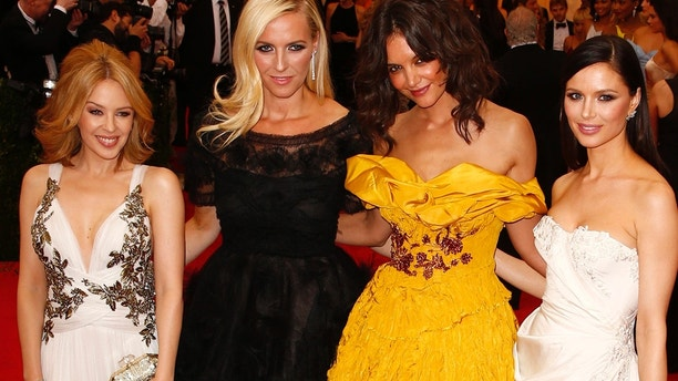 "Actress Katie Holmes poses with Marchesa designers Keren Craig (2nd L) and Georgina Chapman (R) and singer Kylie Minogue (L) as they arrive at the Metropolitan Museum of Art Costume Institute Gala Benefit celebrating the opening of ""Charles James: Beyond Fashion"" in Upper Manhattan, New York, May 5, 2014."