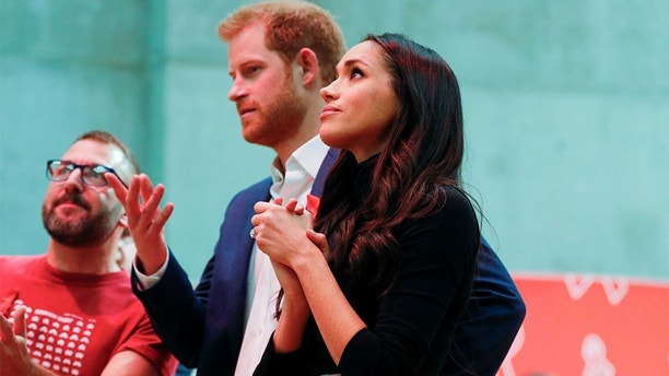 Britain's Prince Harry and his fiancee Meghan Markle visit the Terrence Higgins Trust World AIDS Day charity fair at Nottingham Contemporary in Nottingham, Britain, December 1, 2017. REUTERS/Adrian Dennis/Pool - RC1473D09210