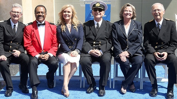 "IMAGE DISTRIBUTED FOR PRINCESS CRUISES - Fred Grandy, from left, Ted Lange, Jill Whelan, Gavin MacLeod, Lauren Tewes and Bernie Kopell attend the ceremony honoring Princess Cruises and the original cast of ""The Love Boat"" with a honorary star plaque at the Hollywood Walk of Fame on Thursday, May 10, 2018 in Los Angeles. (Photo by Casey Rodgers/Invision for Princess Cruises/AP Images)"