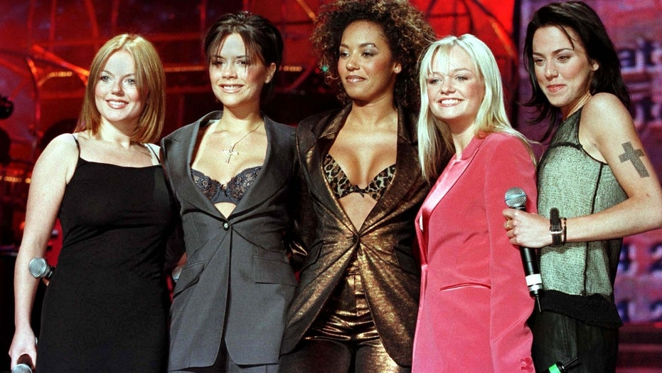 FILE PHOTO DATED 8APR98 - British band the Spice Girls (L-R) Geri, Victoria, Mel B., Emma and Mel C. have, February 24, lost their high court claim against the sponsors of their 1998 tour and will now have to pay around 1million pounds in damages and court costs. The band are seen in this April 1998 file photo as they pose for photographers at the Nynex Arena in Manchester at the start of their tour of England.PS - RP2DRHYBPSAB