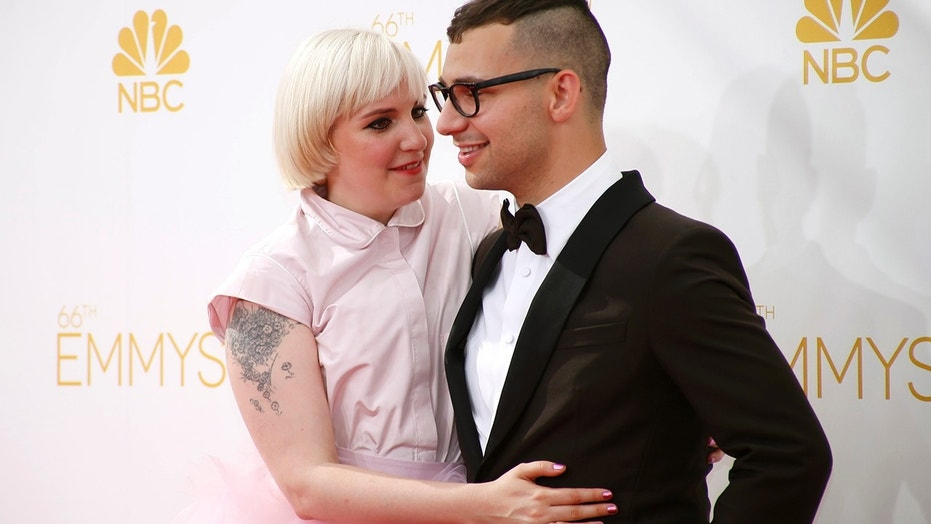 """Lena Dunham from the HBO series """"Girls"""" and Jack Antonoff arrive at the 66th Primetime Emmy Awards in Los Angeles, California August 25, 2014."""
