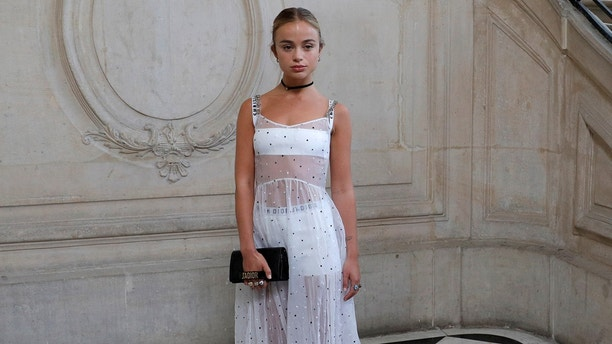 Lady Amelia Windsor poses during a photocall before the Spring/Summer 2018 women's ready-to-wear collection show for fashion house Dior during Paris Fashion Week, France, September 26, 2017.