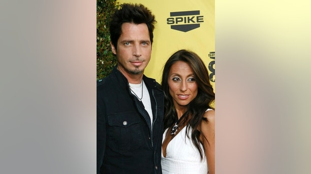 "Singer Chris Cornell and wife Vicky Karayiannis arrive at the first annual Spike television's ""Guys Choice"" awards show in the Studio City area of Los Angeles June 9, 2007.   REUTERS/Gus Ruelas (UNITED STATES) - GM1DVLKBVMAA"