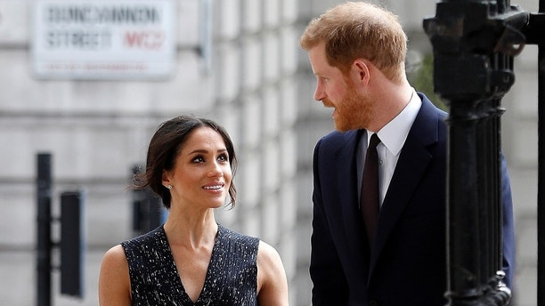 Britain's Prince Harry and his fiancee Meghan Markle arrive at a service at St Martin-in-The Fields to mark 25 years since Stephen Lawrence was killed in a racially motivated attack, in London, Britain, April 23, 2018. REUTERS/Peter Nicholls - RC1642B1D100