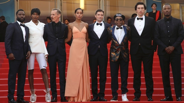 Actors John David Washington, from left, Damaris Lewis, Jasper Paakkonen, Laura Harrier, Topher Grace, director Spike Lee, actors Adam Driver, and Corey Hawkins pose for photographers upon arrival at the premiere of the film 'BlacKkKlansman' at the 71st international film festival, Cannes, southern France, Monday, May 14, 2018. (Photo by Joel C Ryan/Invision/AP)