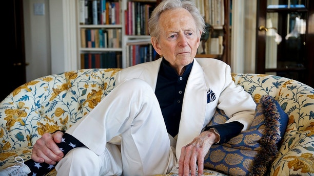 "In this July 26, 2016 file photo, American author and journalist Tom Wolfe, Jr. appears in his living room during an interview about his latest book, ""The Kingdom of Speech,"" in New York. Wolfe died at a New York City hospital. He was 87."