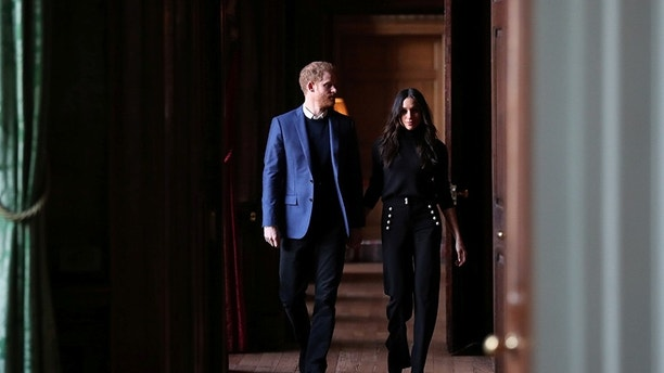 Britain's Prince Harry and his fiancee Meghan Markle attend a reception for young people at the Palace of Holyroodhouse in Edinburgh, Britain February 13, 2018. REUTERS/Andrew Milligan/Pool - RC136BF59D60