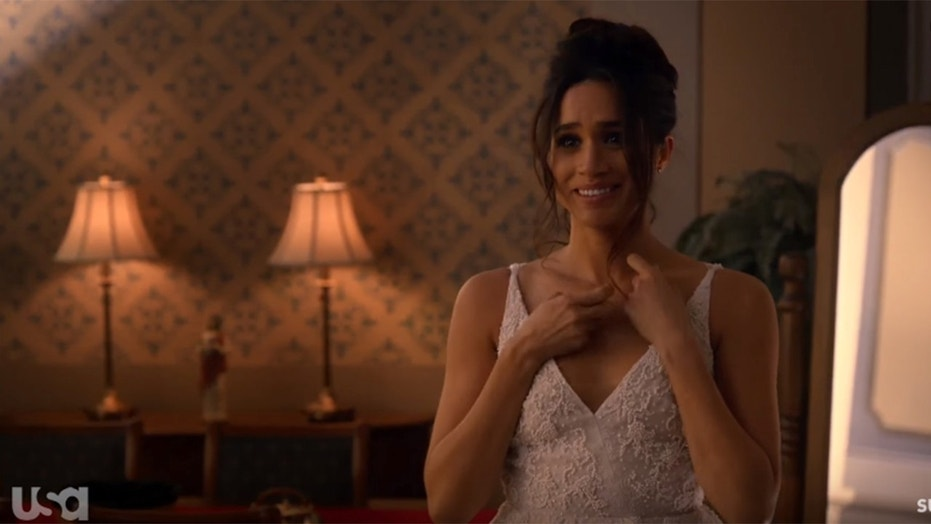 "Meghan Markle wears a wedding dress for the show ""Suits."" Designers are predicting what she will wear to her upcoming wedding to Prince Harry."