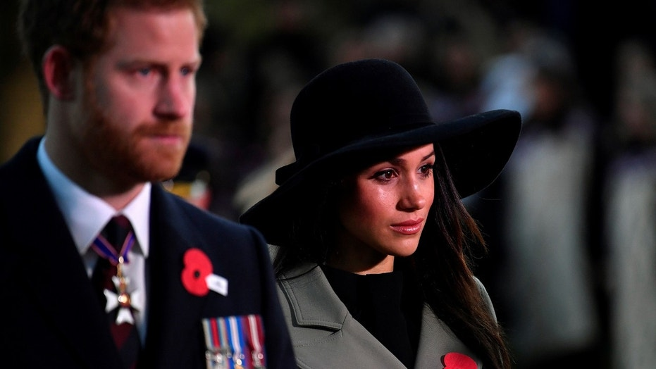 Britain's Prince Harry and his fiancee Meghan Markle attend the Dawn Service at Wellington Arch to commemorate Anzac Day in London, Britain, April 25, 2018. REUTERS/Toby Melville/Pool - RC13432AB280