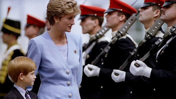 "Princess of Wales, Lady Diana, inspects with her eight-year-old son, Prince Harry, troops at the regiment's base of Bergen-Hohne, July 29. The soldiers of the ""Light Dragoons"" are an armoured reconnaissance regiment - PBEAHUNJSFR"