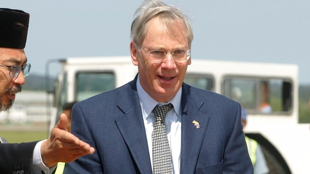 The Duke of Gloucester is greeted as he arrives in Bandar Seri Begawan on September 8, 2004. The Duke arrived in the capital of Brunei on Wednesday for the royal wedding of Brunei's Crown Prince Al-Muhtadee Billah with Dayangku Sarah Pengiran Salleh Ab Rahaman on Thursday. REUTERS/Bazuki Muhammad  BM/PB - RP5DRHZLWTAB