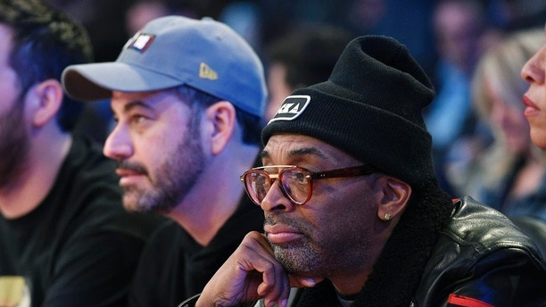 Talks show host Jimmy Kimmel, left, and actor/director Spike Lee  look on during the first half of an NBA All-Star basketball game, Sunday, Feb. 18, 2018, in Los Angeles. (AP Photo/Chris Pizzello)