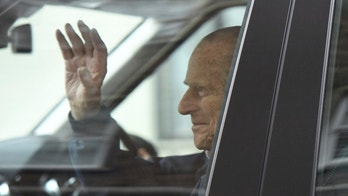 Britain's Prince Philip waves as he leaves the King Edward VII Hospital, after recovering from a planned surgery last Wednesday, in London, Friday, April 13, 2018. (Victoria Jones/PA via AP)