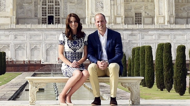 Britain's Prince William and his wife Catherine, the Duchess of Cambridge, pose as they sit in front of the Taj Mahal in Agra, India, April 16, 2016. REUTERS/Money Sharma/Pool      TPX IMAGES OF THE DAY - GF10000384294