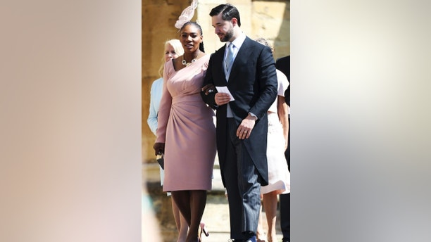 Serena Williams and Alexis Ohanian arrive for the wedding ceremony of Prince Harry and Meghan Markle at St. George's Chapel in Windsor Castle in Windsor, near London, England, Saturday, May 19, 2018. (Chris Jackson/pool photo via AP)