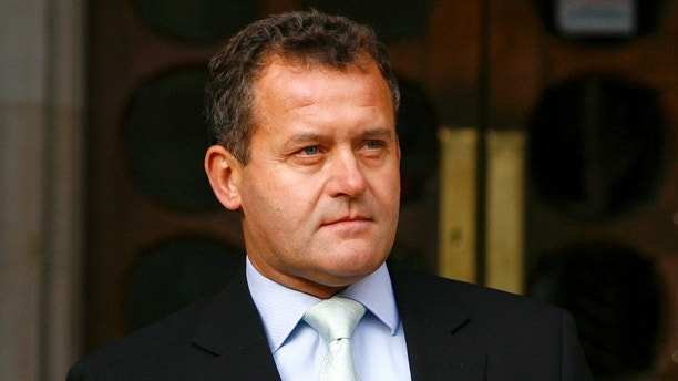Princess Diana's former butler Paul Burrell poses for photographers at the High Court in London January 14, 2008. Burrell gave evidence to the inquest into the deaths of Princess Diana and Dodi al-Fayed.      REUTERS/Luke MacGregor     (BRITAIN) - LM1DXARDGVAA