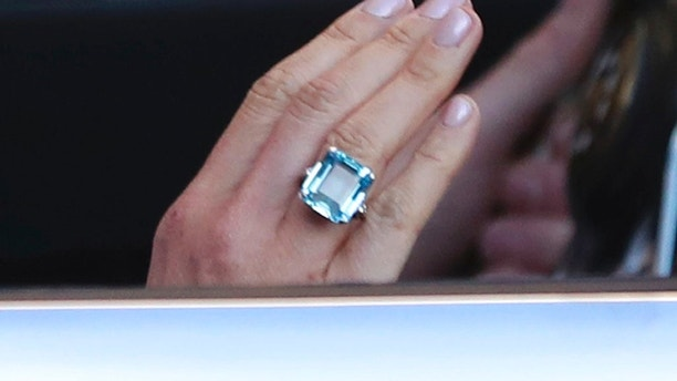 This May 19, 2018 photo shows a close up of the ring worn by the newly married Duchess of Sussex, Meghan Markle leaving Windsor Castle with Prince Harry after their wedding to attend an evening reception at Frogmore House, hosted by the Prince of Wales. The bride wore a ring which belonged to Diana, Princess of Wales. (Steve Parsons/PA via AP)