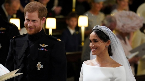 Prince Harry and Meghan Markle in St George's Chapel at Windsor Castle during their wedding service Windsor, Britain May 19, 2018.  Jonathan Brady/Pool via REUTERS - RC1B60164480