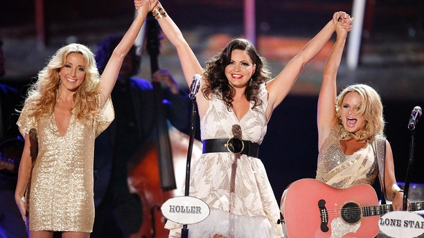 Musicians Ashley Monroe (L), Angaleena Presley, and Miranda Lambert (R) of the Pistol Annies perform at the 2012 CMT Music Awards in Nashville, Tennessee, June 6, 2012.