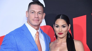 "Cast member John Cena (L) and Nikki Bella attend the premiere of ""Blockers"" in Los Angeles, California, U.S. April 3, 2018. REUTERS/Phil McCarten - RC1DBF93F9A0"