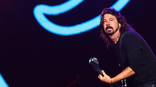 Dave Grohl, lead singer of The Foo Fighters, performs during the Global Citizen Festival at Central Park in New York September 29, 2012. 