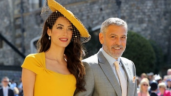 Amal Clooney and George Clooney arrive at St George's Chapel at Windsor Castle for the wedding of Meghan Markle and Prince Harry.  Saturday May 19, 2018.  Gareth Fuller/Pool via REUTERS - RC1DA1F30DA0
