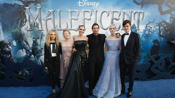 "Cast members (L-R) Juno Temple, Lesley Manville, Angelina Jolie, Sharlto Copley, Elle Fanning and Sam Riley pose at the premiere of ""Maleficent"" at El Capitan theatre in Hollywood, California May 28, 2014. The movie opens in the U.S. on May 30.   REUTERS/Mario Anzuoni  (UNITED STATES - Tags: ENTERTAINMENT) - GM1EA5T0ZMC01"
