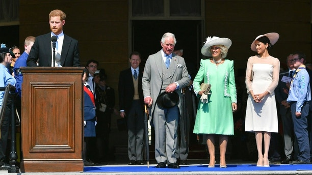Britain's Prince Harry speaks, as Prince Charles, Camilla, the Duchess of Cornwall and Meghan, the Duchess of Sussex listen, during a garden party at Buckingham Palace in London, Tuesday May 22, 2018. The event is part of the celebrations to mark the 70th birthday of Prince Charles.  (Dominic Lipinski/Pool Photo via AP)