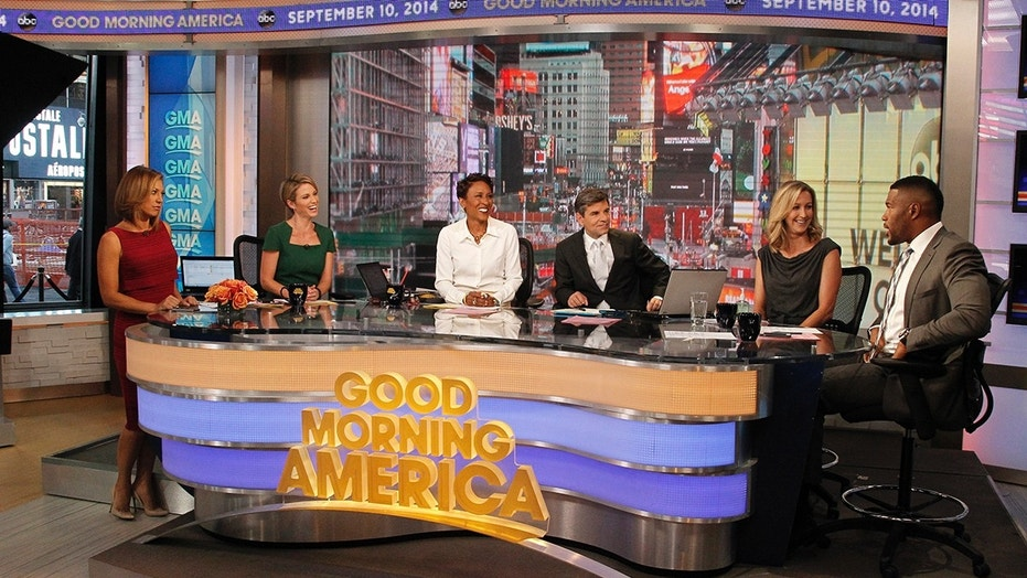 """GOOD MORNING AMERICA - Michael Strahan on """"Good Morning America,"""" 9/10/14, airing on the ABC Television Network. (ABC/Lou Rocco)GINGER ZEE, AMY ROBACH, ROBIN ROBERTS, GEORGE STEPHANOPOULOS, LARA SPENCER, MICHAEL STRAHAN"""