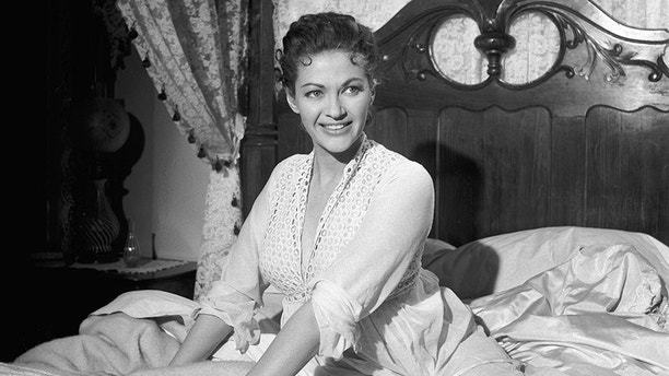 """** RETRANSMISSION FOR BETTER QUALITY **FILE**Actress Yvone De Carlo appears on the set of the film """"Band of Angels""""on Warner Bros. Burbank, Calif., lot, in this February 1957 file photo.  Carlo, the beautiful star who played Moses' wife in """"The Ten Commandments"""" but achieved her greatest popularity on TV's """"The Munsters,"""" died Monday, Jan. 8, 2007 in suburban Los Angeles. She was 84. (AP Photo/Mike Smith)"""