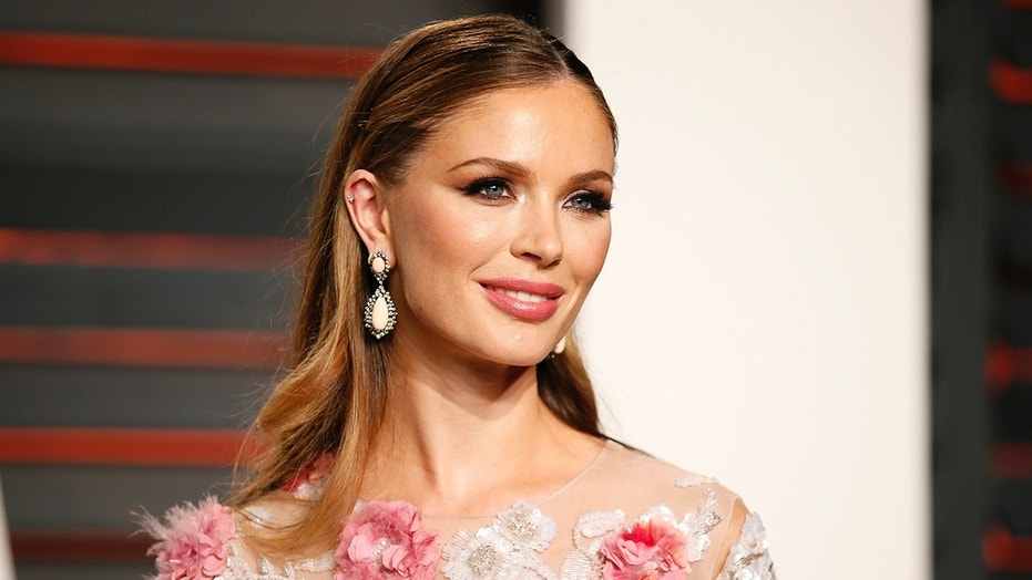 Designer Georgina Chapman arrives at the Vanity Fair Oscar Party in Beverly Hills, California February 28, 2016.  REUTERS/Danny Moloshok - TB3EC2T0L4CEB