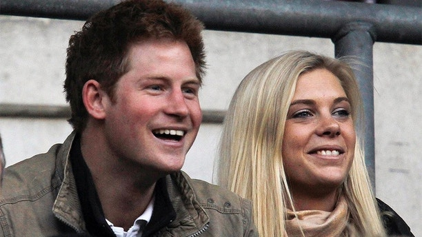 Britain's Prince Harry (L) and Chelsy Davy attend the friendly international rugby union match between England and Australia at Twickenham in London November 7, 2009.   REUTERS/ Eddie Keogh (BRITAIN ROYALS SPORT RUGBY) - GM1E5B802ZC01