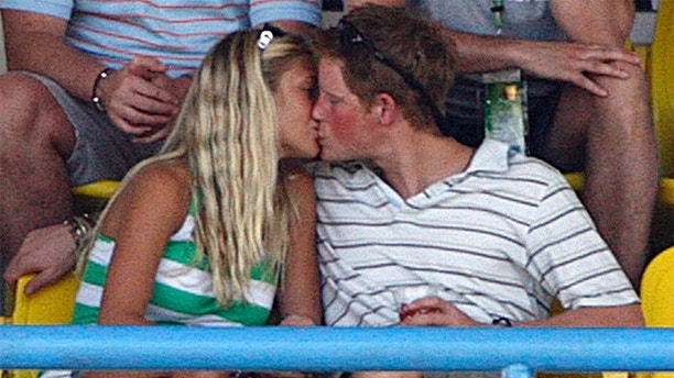 Britain's Prince Harry (R) kisses his girlfriend Chelsy Davy as England plays Australia during their World Cup cricket Super Eights match in St. John's April 8, 2007.   MOBILES OUT, EDITORIAL USE ONLY REUTERS/Darren Staples    (ANTIGUA AND BARBUDA) - GM1DUZQUXEAA