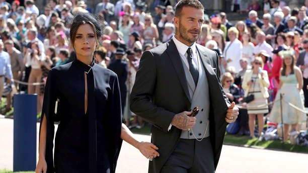 David and Victoria Beckham arrive at St George's Chapel at Windsor Castle for the wedding of Meghan Markle and Prince Harry.  Saturday May 19, 2018.  Chris Radburn/Pool via REUTERS - RC111C4BE7A0
