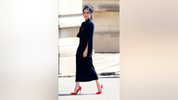 British fashion designer Victoria Beckham arrives for the royal wedding ceremony of Britain's Prince Harry and Meghan Markle at St George's Chapel in Windsor Castle, in Windsor, Britain, 19 May 2018.  LAUREN HURLEY/Pool via REUTERS - RC1C24B34D80