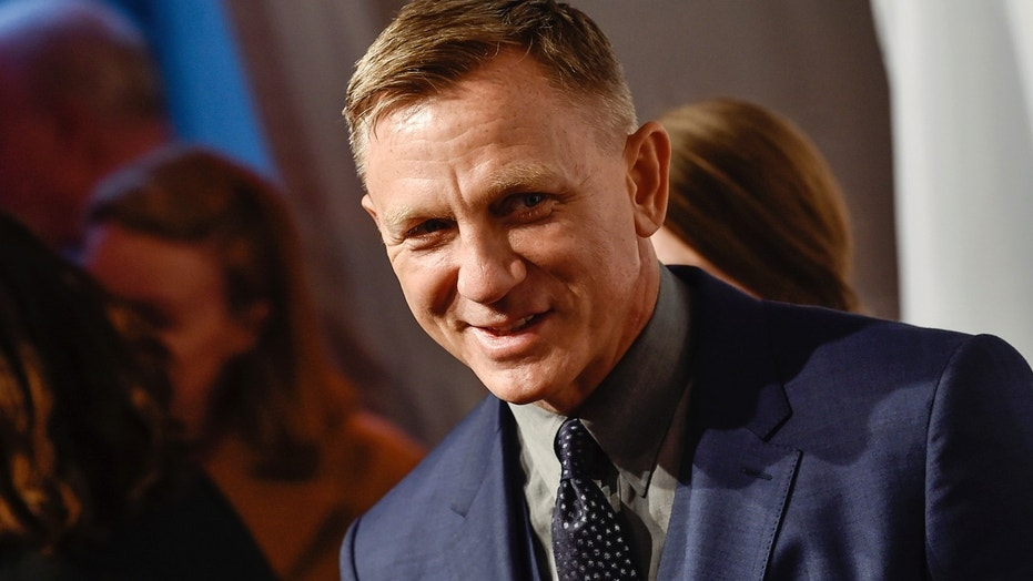 FILE - In this Monday, April 9, 2018, file photo, actor Daniel Craig attends The Opportunity Network's 11th Annual Night of Opportunity Gala at Cipriani Wall Street in New York. After more than a decade at Sony Pictures, James Bond has a few new homes. In a joint announcement with their new partners Thursday, May 24, 2018, Michael G. Wilson and Barbara Broccoli said Universal Pictures will release the 25th installment of the superspy franchise internationally while MGM will release the film in the U.S. Craig will be reprising his role as 007 in the film and Oscar-winner Danny Boyle will direct. (Photo by Evan Agostini/Invision/AP, File)