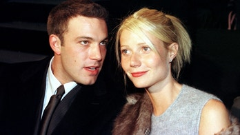 U.S. actress Gwyneth Paltrow (R) and Ben Affleck watch Giorgio Armani's Spring/Summer '99 collection October 10. Armani's show was the last one in a series of collections that began on October 2. - PBEAHUMGUCN