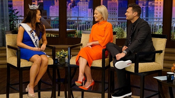 "Kelly Ripa and Ryan Seacrest talk with Miss America Cara Mund during the production of ""Live with Kelly and Ryan"" in New York on Tuesday, Sept. 12, 2017.