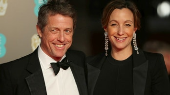 Hugh Grant and Anna Eberstein arrive for the British Academy of Film and Television Awards (BAFTA) at the Royal Albert Hall in London, Britain, February 18, 2018. REUTERS/Hannah McKay - RC160A3E1EA0