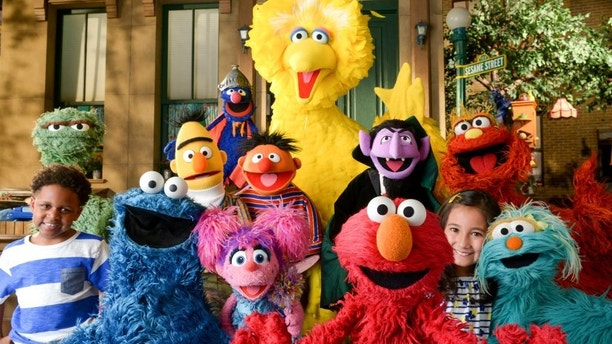 "This image released by the Sesame Workshop shows the cast of ""Sesame Street."" The popular children's show begins its 46th season on HBO on Saturday, Jan. 16, 2016.  (Zach Hyman/Sesame Workshop via AP)"