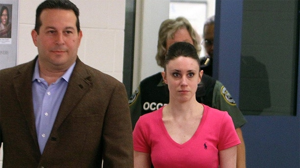 Casey Anthony and her lawyer Jose Baez (L) leave the Orange County Jail  in Orlando, Florida July 17, 2011. Anthony was released from a Florida jail on Sunday to resume the life interrupted three years ago when she was charged with the murder of her 2-year-old daughter Caylee. Anthony was acquitted by a jury on July 5 of culpability in Caylee's death.  REUTERS/Red Huber/Pool (UNITED STATES - Tags: CRIME LAW SOCIETY) - GM1E77H104201