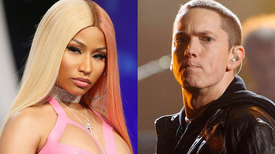 Eminem tells fans during a concert that he would like to date Nicki Minaj after rumors swirled that the two were dating.