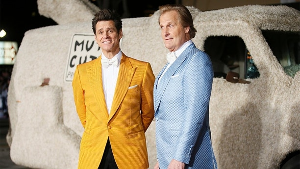 "Actors Jim Carrey (L) and Jeff Daniels arrive in a van decorated as a dog at the world premiere of the film ""Dumb and Dumber To"" in Los Angeles, November 3, 2014.   REUTERS/Danny Moloshok   (UNITED STATES - Tags: ENTERTAINMENT) - GM1EAB40ZY501"