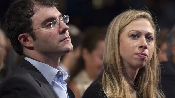 Chelsea Clinton, daughter of former U.S. President Bill Clinton, looks on along with her husband, Marc Mezvinsky, during the first day of the Clinton Global Initiative 2012 (CGI) meeting in New York, September 23, 2012.