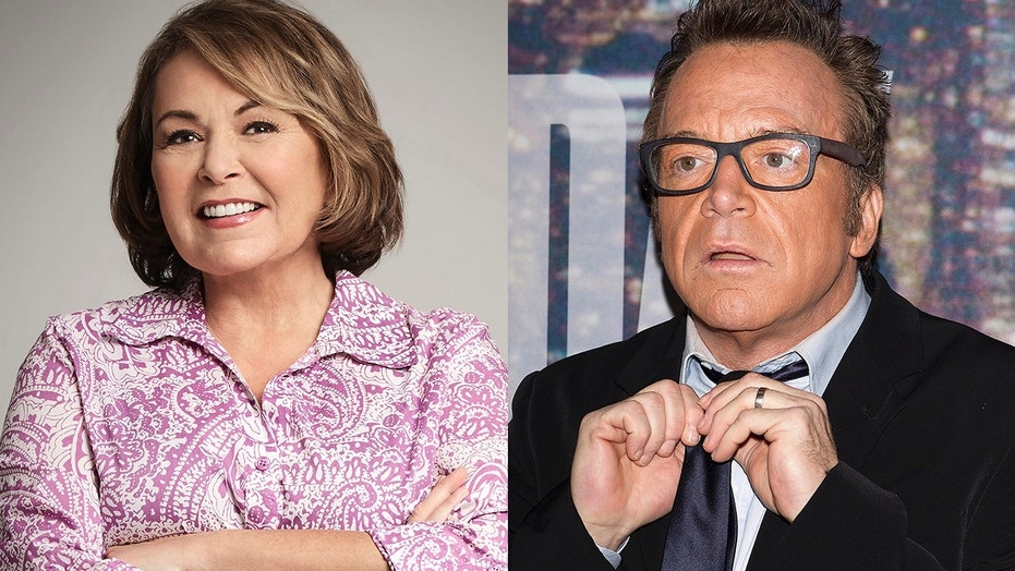 Tom Arnold, right, slammed his ex-wife Roseanne Barr following the cancellation of her ABC series.